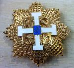 OCT Grand Cross breast star